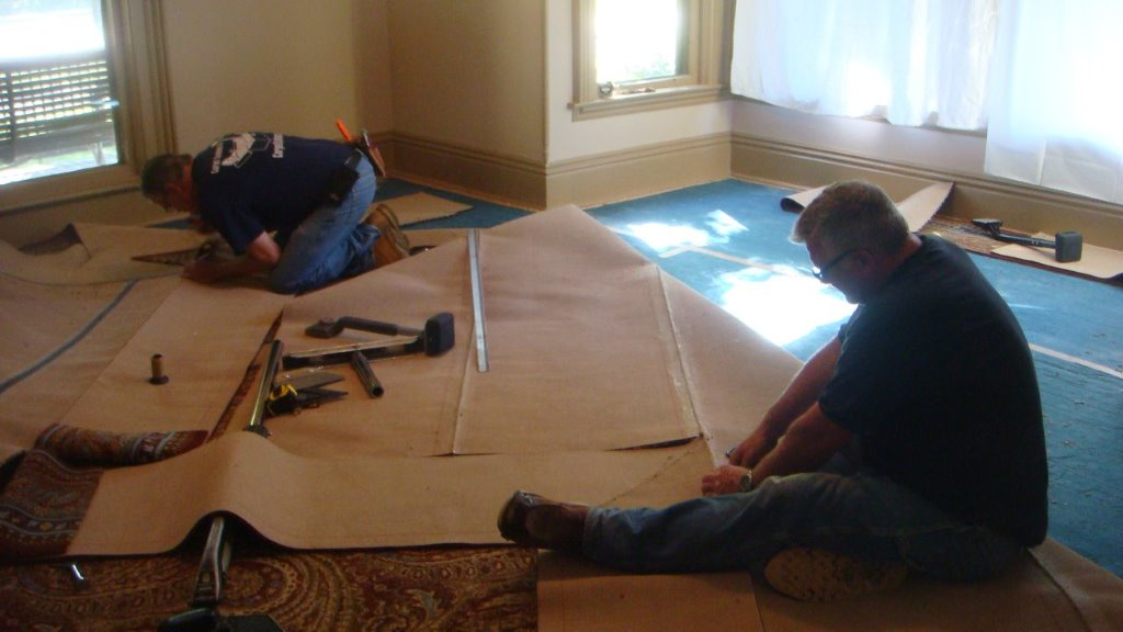 Randy and Dave from Eagle Carpet Services preparing the carpet for installation