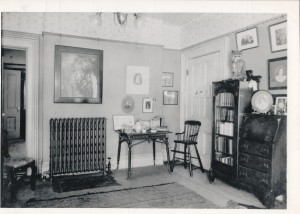 Historic image (ca. 1930?) of the west wall of the Office showing a radiator